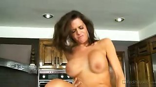 Watch this sexy MILF fuck the gardener in her family kitchen