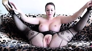 Big breasted brunette in lingerie takes herself to climax