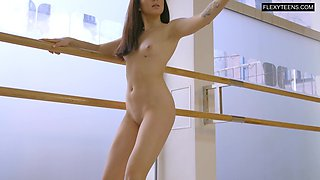 Adorable babe doing ballet warm ups completely naked