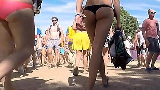 Beach voyeur follows a sexy slender girl with a lovely ass