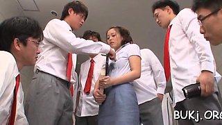 Honey kneels and begins sucking knobs in school bukkake
