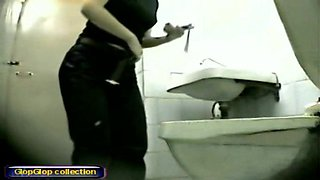Beautiful temptress demonstrates her butt in the toilet