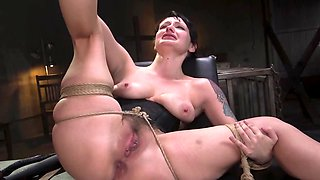 Bald dominant man focuses on pussy of tied up female slave