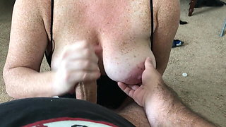 Cumming on freckled tits