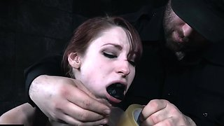 Gagged and bound slave toyed by her dom