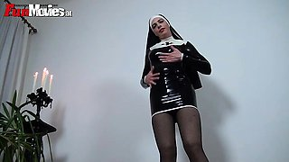 Kinky babe in latex nun suit posing seductively