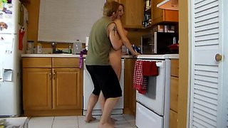 Mother needs some help in the kitchen from her son