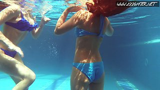 Acting naughty Lina Mercury undresses another gal right underwater