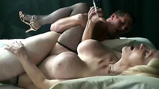 Smoking grandma with fake tits gets fucked