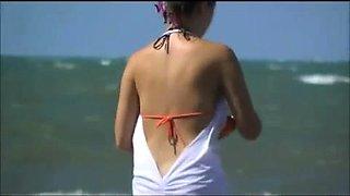 Beach voyeur spies on a busty blonde teen with a perfect ass