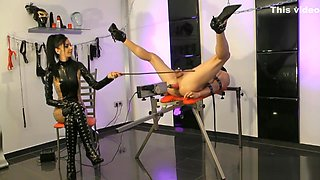 Mistress Zita Smoking while slave gets Strapon
