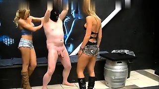 Masked slave has two sexy babes punishing his cock and balls