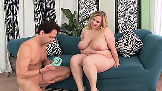 A guy sucks on sexy, blond plumper Nikky Wilder's tits, and