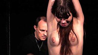 Stimulation for slave restrained in bondage bdsm