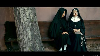 Sexy nuns are playing with each other in front of the camera