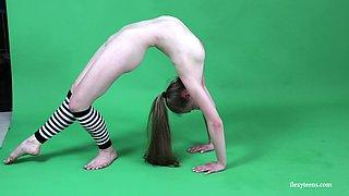 Petite Anna Mostik finally decides to get naked before the cameras