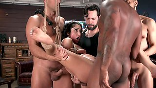 Tied up girl is being gangbanged by a bunch of studs