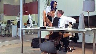 Three women jump on a dude in the office for a foursome