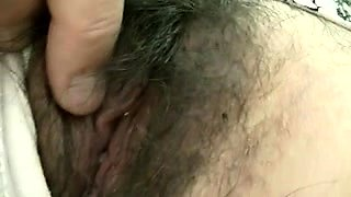 Sleeping Asian cutie has a stranger fingering her hairy cunt