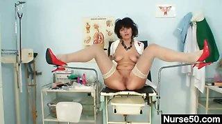 Busty amateur milf wears latex uniform and high heels