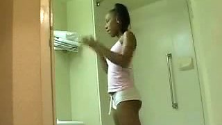 Ebony babe barenaked in the bathroom