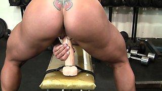 Bella Money Fucks A Dildo In The Gym