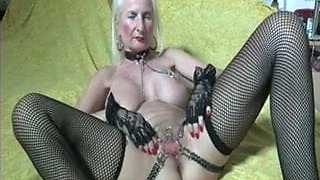 Pierced granny with chains to her pierced pussy lips