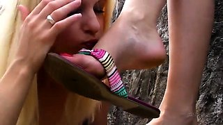 Exciting lesbian friends explore their foot fetish outside