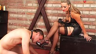 Leather dress mistress abuses him