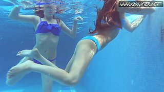 Russian swimmer Lina Mercury and her girlfriend show underwater striptease