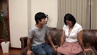 Mature Japanese lady fucks a dildo and seduces a young man