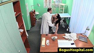 Fake doctor pussylicks nurse on exam table
