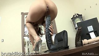 A wild girl tries her best to fuck some gigantic dildos