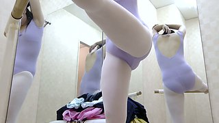 Teen chick with small tits puts on her tricot on spy cam