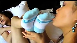 Two playful Asian lesbians explore their foot fetish fantasy