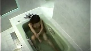 Naked Asian babe washing her hairy pussy and perky small boobs before masturbating