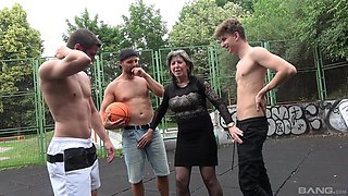 Dirty granny gets fucked on the basketball court by a lot of dudes