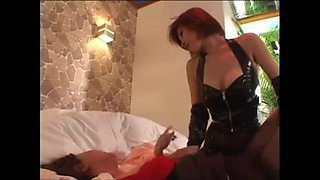 Dominat Woman In Latex Teases Her Slave