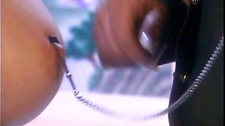 Lesbo in latex torturing slave