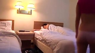 sister and brother share a hotel room