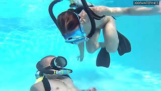 Nude diving girl in scuba Minnie Manga gives a good blowjob under the water