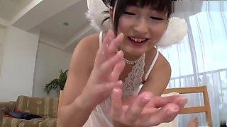 Beautiful Japanese teenage girl Maria Kotobuki making guy happy by giving an amazing handjob