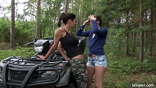Two voluptuous lesbians are finger fucking each others snatches in the forest