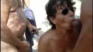 French granny bitch -bukkake among the dunes of a beach-