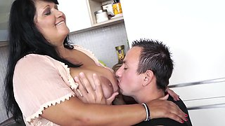 A fat olf woman is in the kitchen, getting fucked by a nasty dude