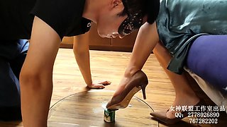 Dominant Japanese lady has a masked slave licking her feet