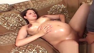 Pretty nine month pregnant chick oiled and fucked