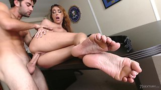 Sexy officer in uniform is fucked hard by strict boss right on the table