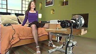 Brunette hottie in fishnets gets stuffed by a machine