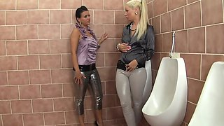 Messy toilet lesbian action with pissing girls Laetitia and Candy
